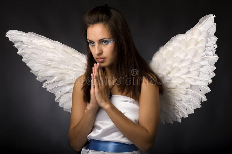 Pretty young angel. In white cloth stock images