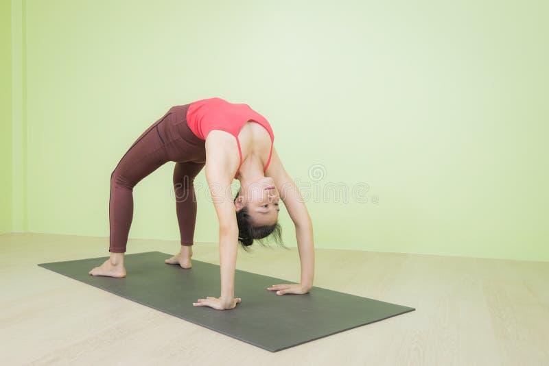 Upward facing bow yoga pose stock photography