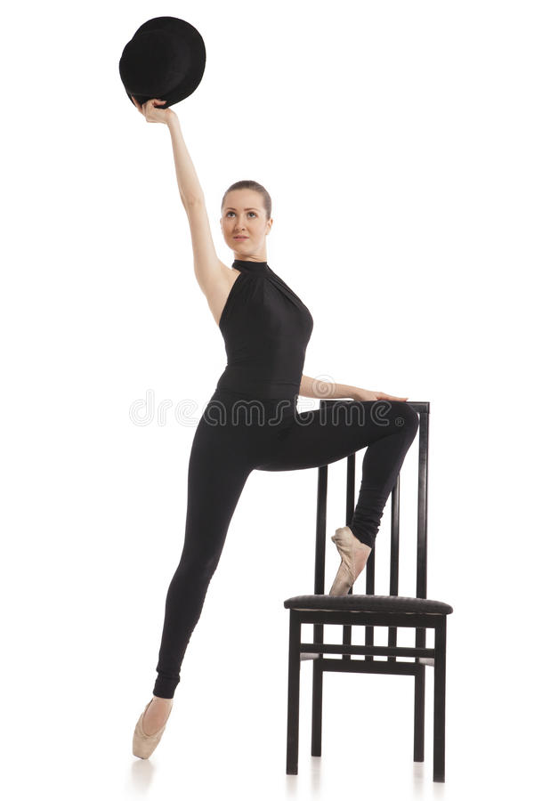 Pretty young ballerina posing with chair. Isolated royalty free stock photos