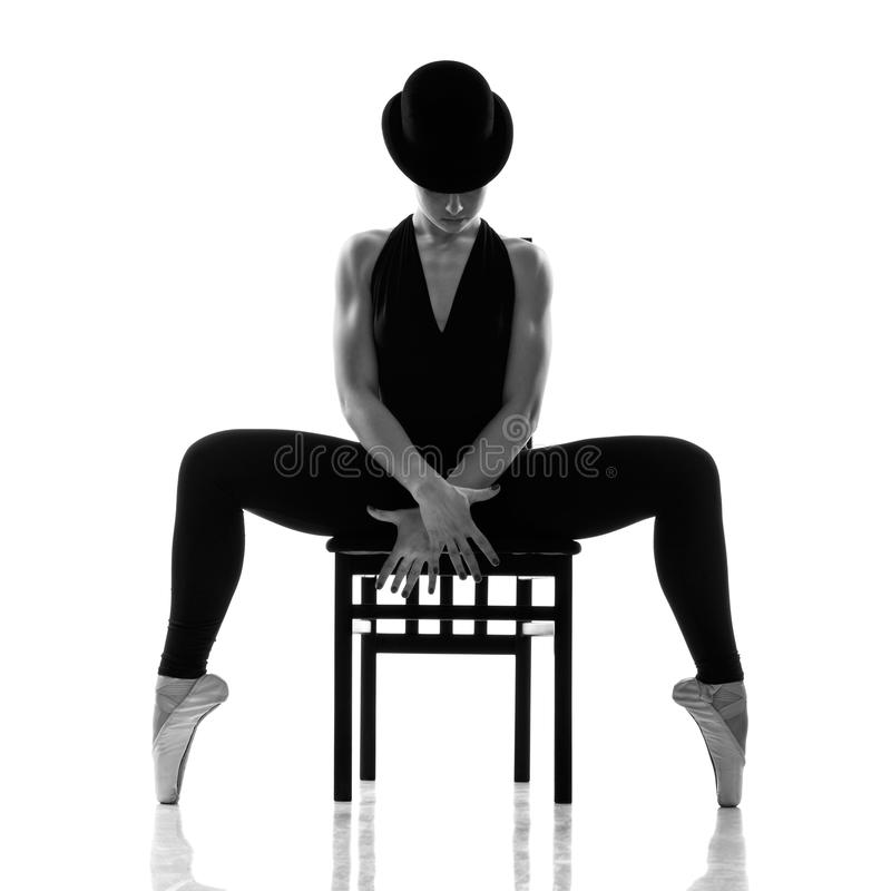 Pretty young ballerina sitting on the chair. Isolated royalty free stock images