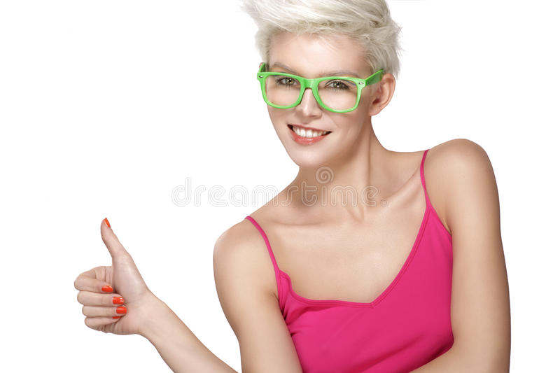 Pretty young blond model wearing cool eyeglasses stock photo