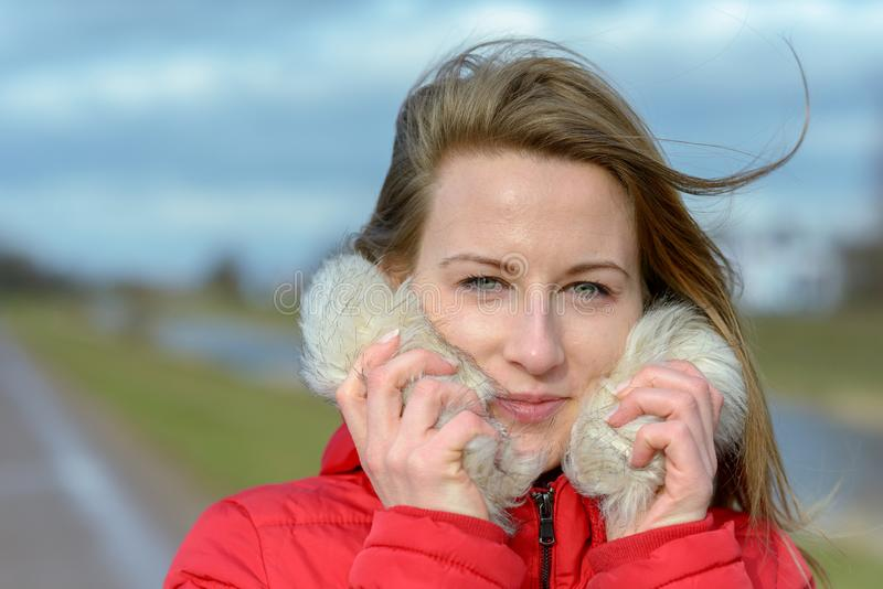 Pretty young blond woman outdoors in winter stock photography