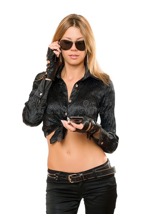 Pretty young blonde with a two phones stock images