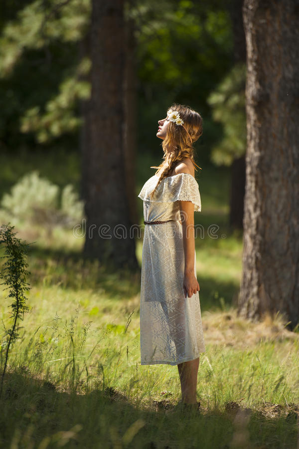 Pretty Young Boho Woman Standing in Forest stock photography