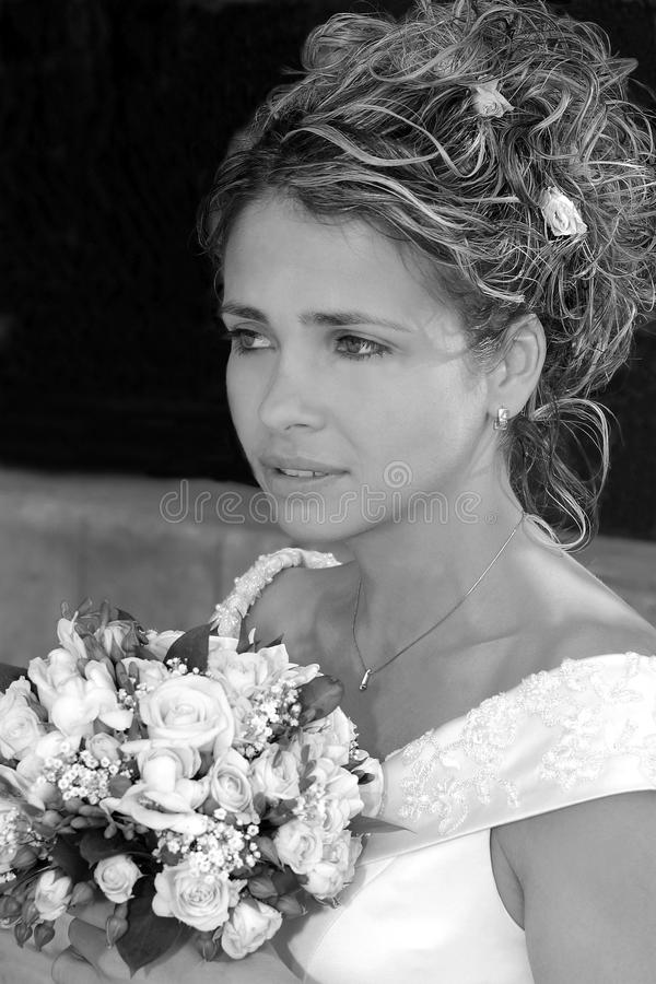 Pretty young bride with bouquet royalty free stock images