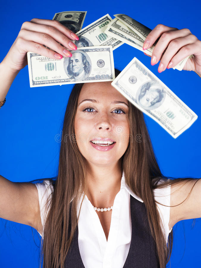 Pretty young brunette real modern woman with money cash on blue background happy smiling, lifestyle people concept stock image