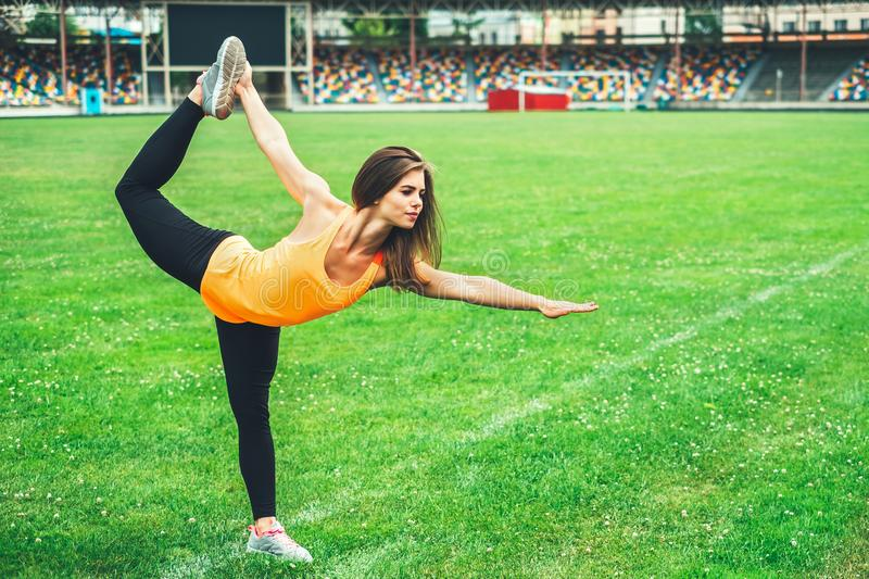 Cute young brunette sporty girl workout outdoor stock photos