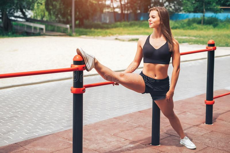 Cute young brunette sporty girl workout outdoor stock photo