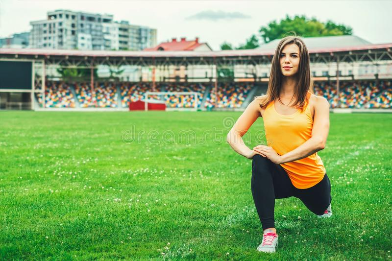 Cute young brunette sporty girl workout outdoor royalty free stock photos