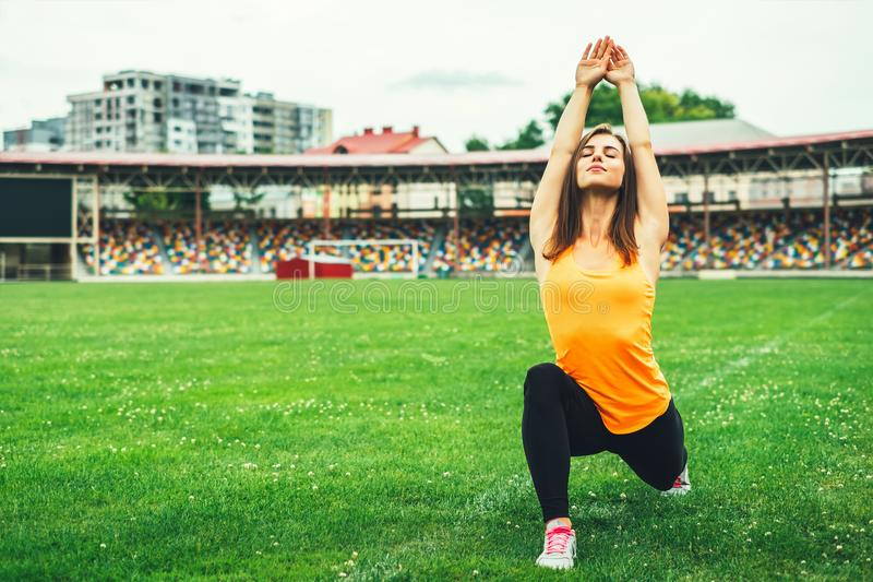 Cute young brunette sporty girl workout outdoor stock photography