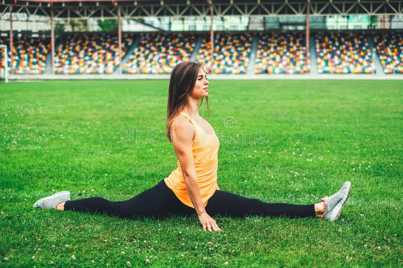 Cute young brunette sporty girl workout outdoor stock images