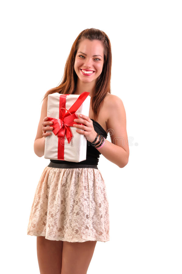 Pretty young brunette woman dressed in dress holding white gift royalty free stock photo