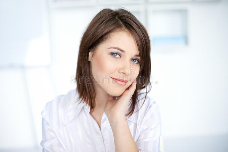 Pretty young business woman at office royalty free stock photo