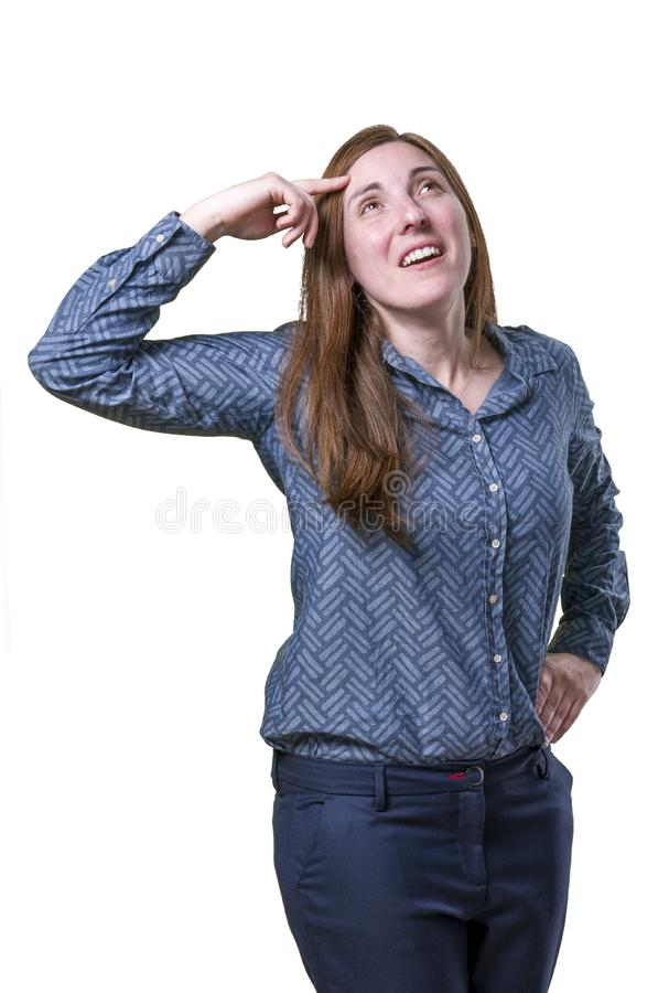 Pretty young business woman is thinking, has an idea.  stock photo