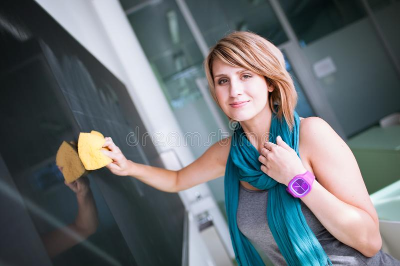 Pretty young college student writing on the chalkboard stock photography