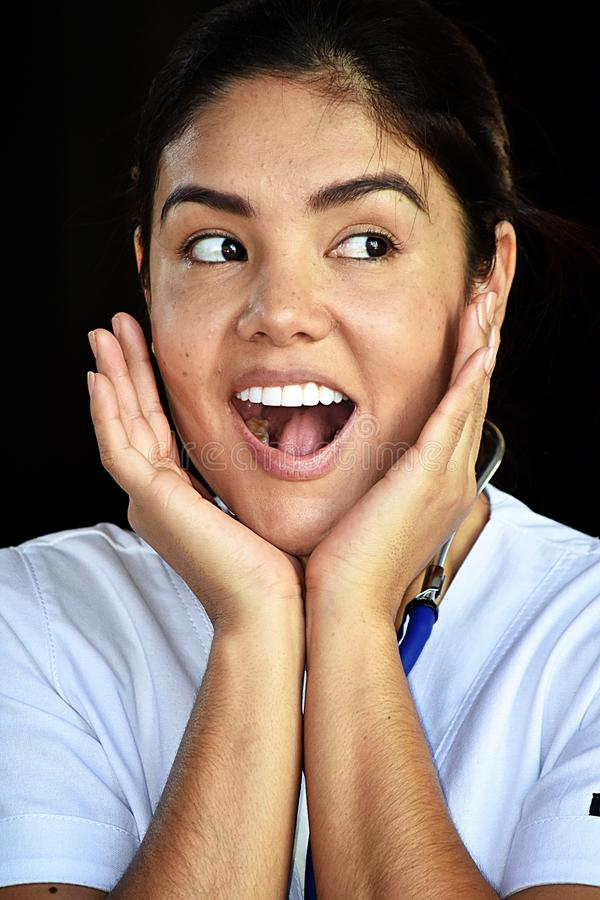 Surprised Female Nurse Wearing Scrubs. A pretty young Colombian adult female stock image