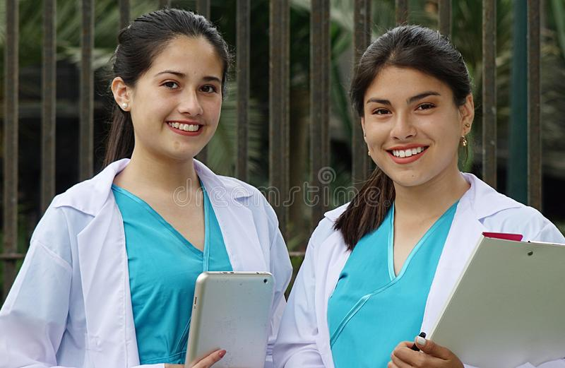 Youthful Peruvian Girl Nurse. A pretty young Colombian adult female royalty free stock photo