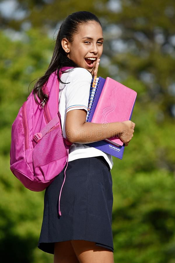 Latina Female Student Having Fun Wearing Uniform. A pretty young Colombian teen girl stock photography