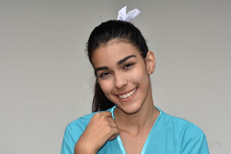 Pretty Young Female Nurse. A pretty young Colombian teen girl stock image