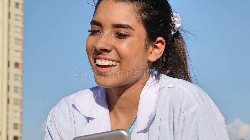 Young Female Teenager Nurse. A pretty young Colombian teen girl stock photography