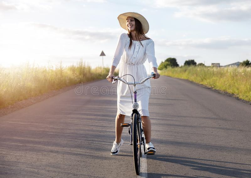 Pretty Young Cyclist Girl Admires Sunset royalty free stock photos