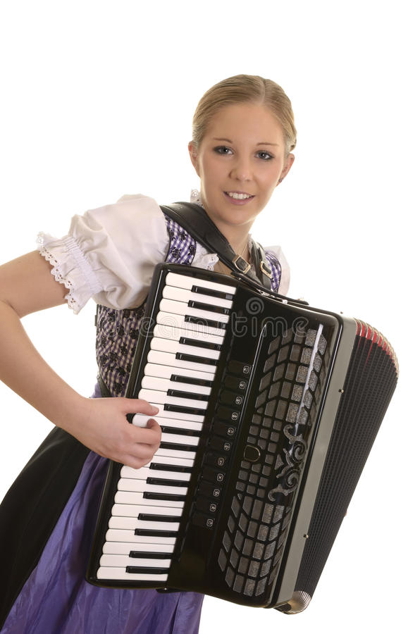 Pretty young drindl woman playing accordion royalty free stock images