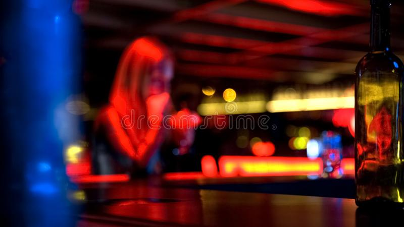 Pretty young female with glass drinking cocktail at bar, blurred background. Stock photo royalty free stock photos