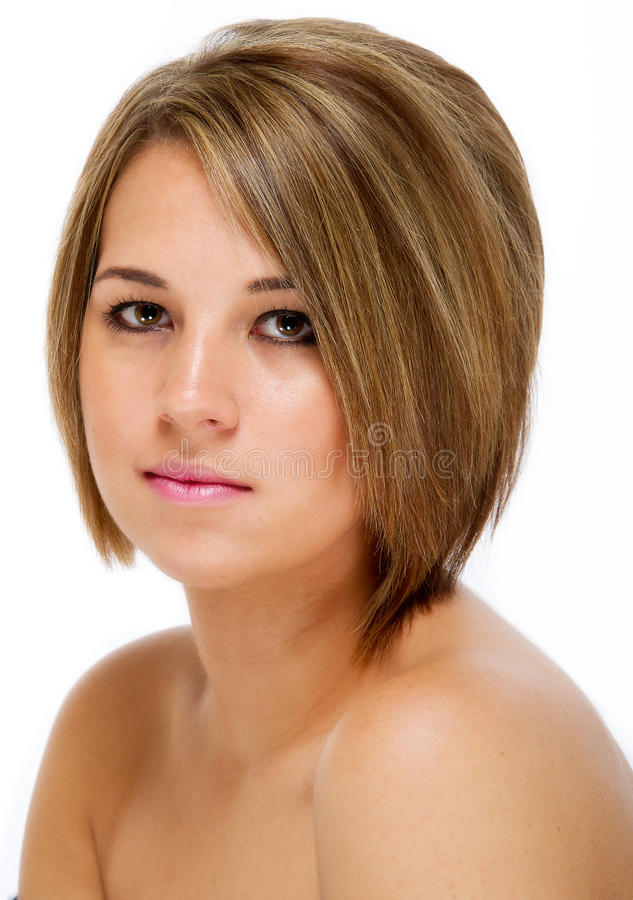 Pretty young female head shot against white stock photos