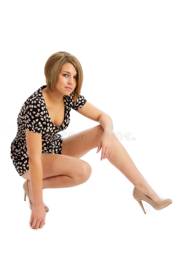 Pretty young female isolated in heels stock photos