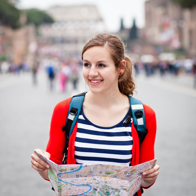 Download Pretty Young Female Tourist Holding A Map Stock Photo - Image: 23617406