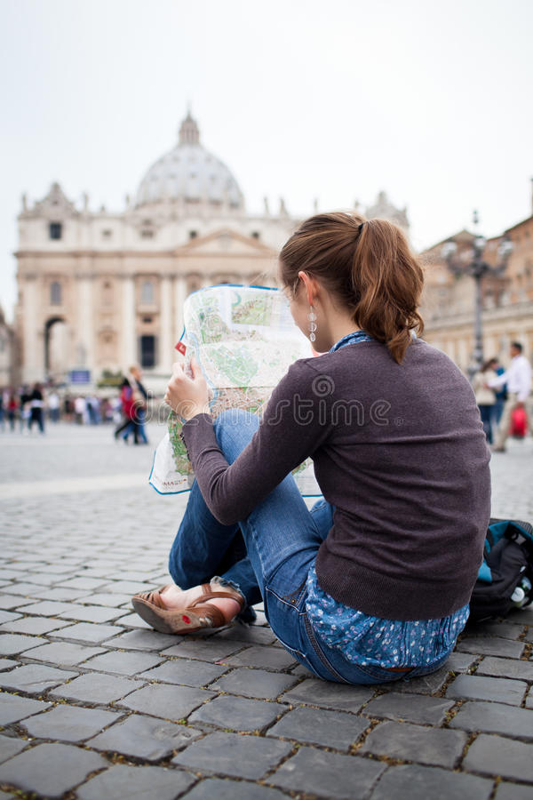Download Pretty Young Female Tourist Studying A Map Stock Photo - Image of female, happy: 24095694