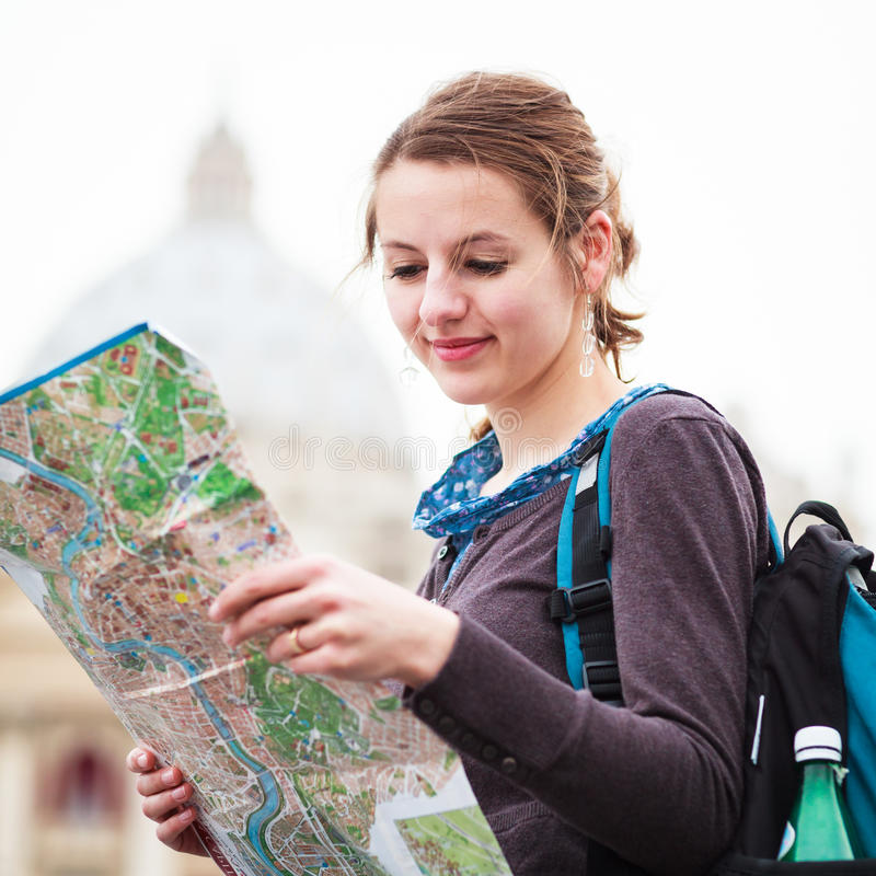 Download Pretty Young Female Tourist Studying A Map Stock Image - Image: 26325981