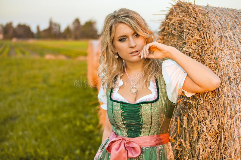 pretty young german oktoberfest blonde woman wearing a dirndl stock image image of holidays. Black Bedroom Furniture Sets. Home Design Ideas