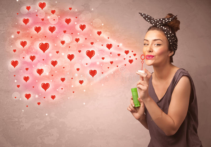 Download Pretty Young Girl Blowing Red Heart Symbols Stock Image - Image of hearts, heart: 49872159