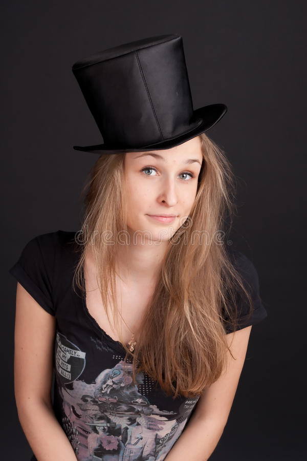 Download Pretty Young Girl In A Cylinder Stock Photo - Image: 18456994