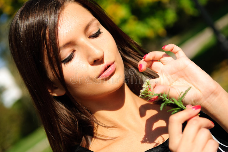 Pretty young girl with flower stock images