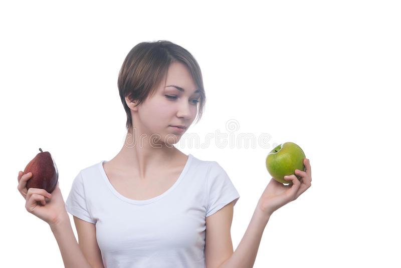 Pretty young girl with green apple stock photos