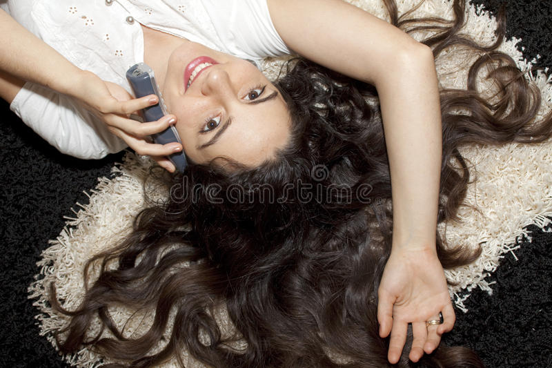 Download Pretty Young Girl Lying On Carpet With Telephone Stock Image - Image: 11405571