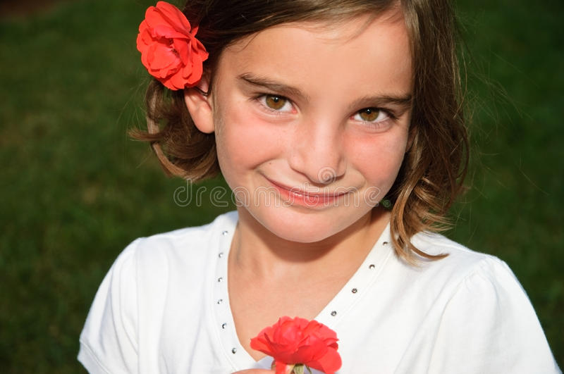 Pretty Young Girl with Roses stock photos