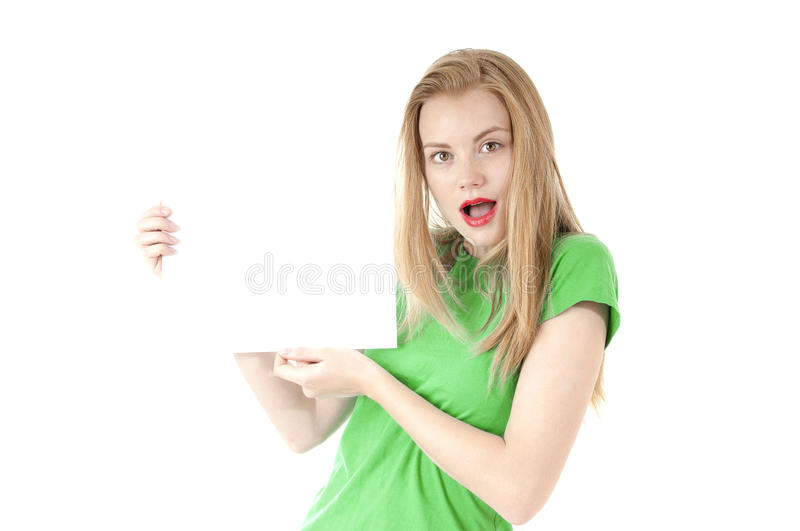 Pretty young girl showing empty blank paper sign for text. Cute. Girl wearing glassed and green tee-shirt on white background stock image