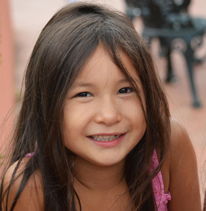 pretty young girl smiling outside royalty free stock photos