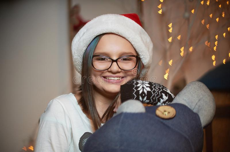 Pretty young girl spending Christmas eve at home royalty free stock image