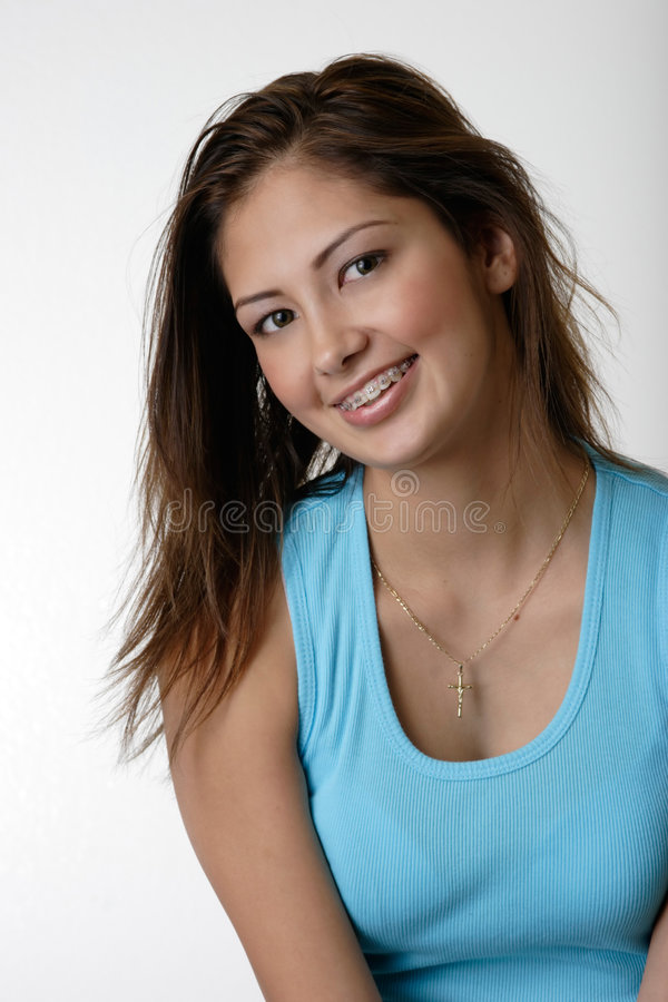 Pretty young girl wearing braces stock photo