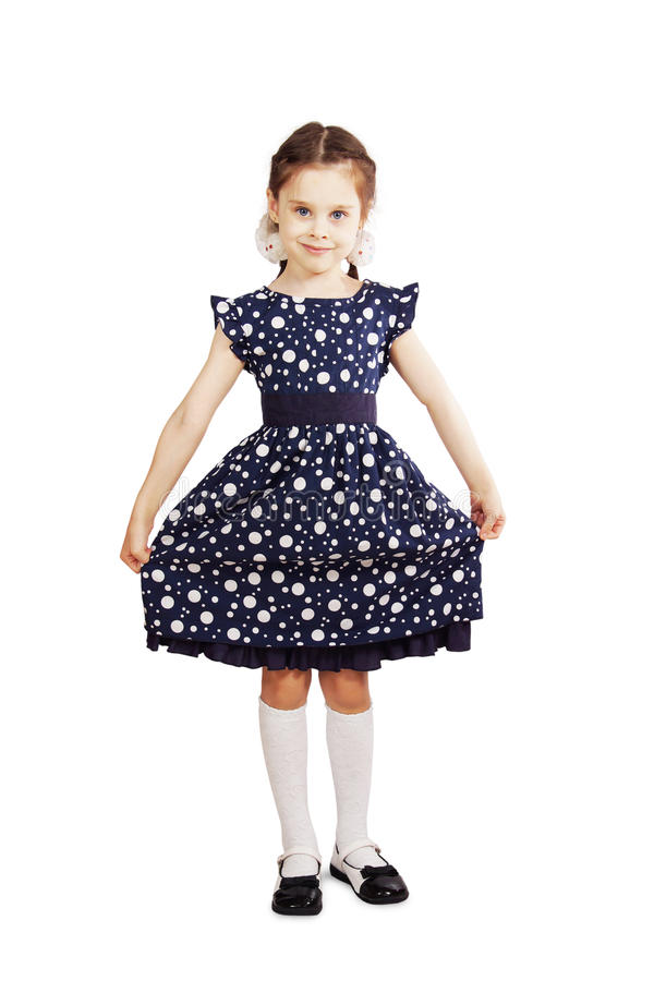 Pretty young girl wearing the dark blue dress. Over white background stock image