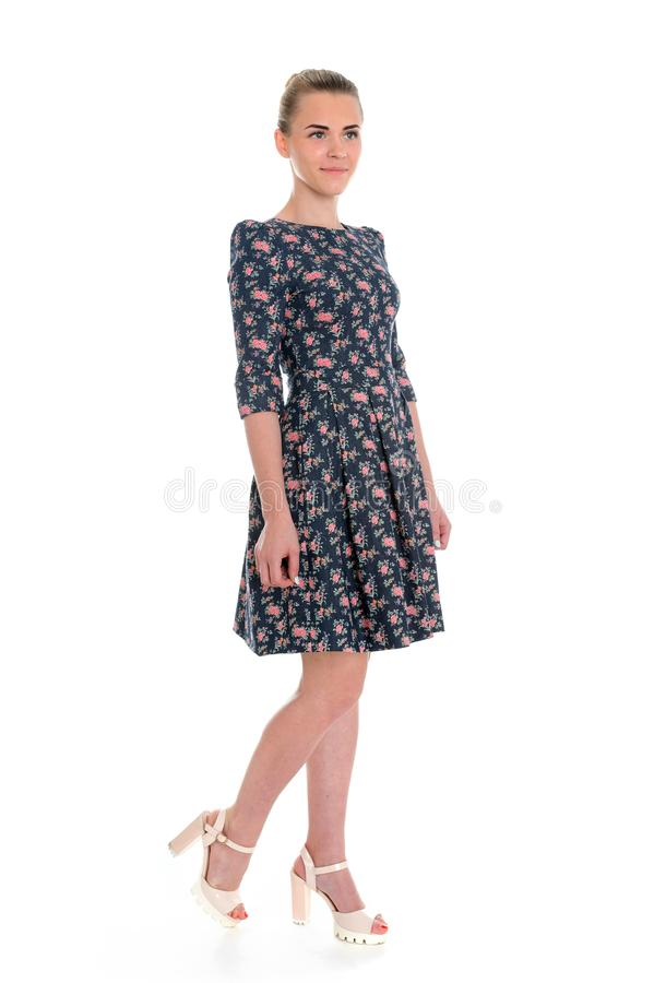 Pretty young girl wearing a flower printed dress royalty free stock photography