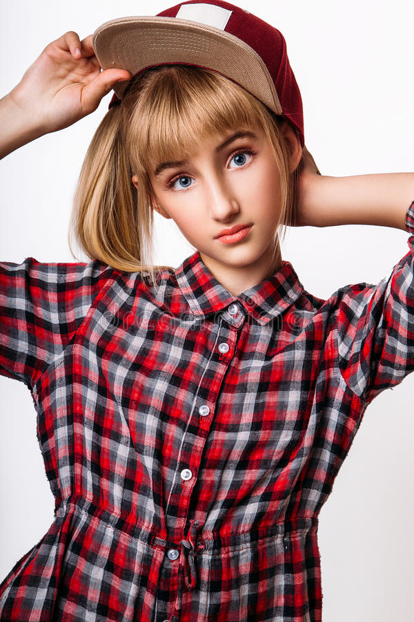 A pretty young girl on the white background royalty free stock image