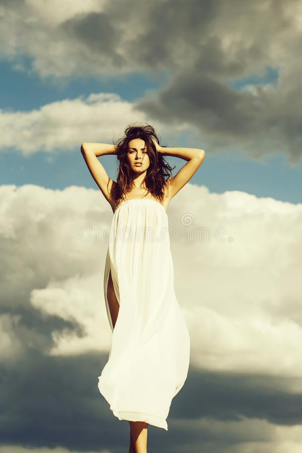 Pretty girl over blue sky royalty free stock photography