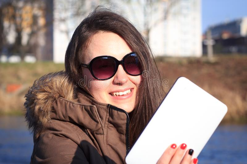 Pretty young girl / woman with sunglasses taking a selfie in the stock photos
