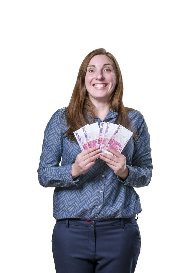 Pretty young happy business woman taking a lot of money over white background royalty free stock images