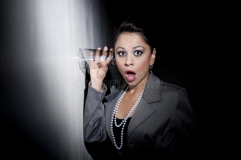 Download Pretty Young Hispanic Woman Using Glass To Eavesdr Royalty Free Stock Image - Image: 9542346